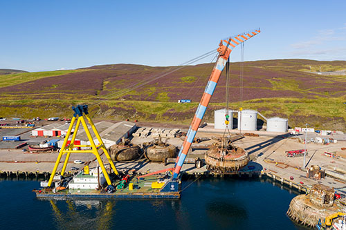 Shearleg crane Hebo 9 lifts a Buchan Alpha pontoon at Greenhead Base